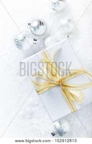White Christmas gift with golden ribbon