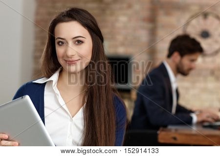 Portrait of attractive young businesswoman, smiling, looking at camera.