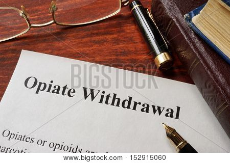 Opiate withdrawal written on a paper. Drugs addiction concept.