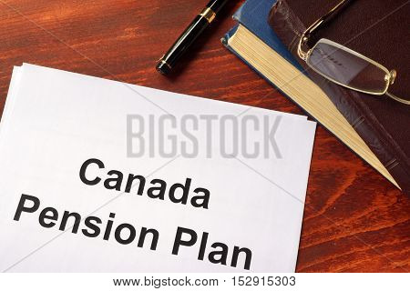 Canada Pension Plan CPP written on a sheet on an office table.