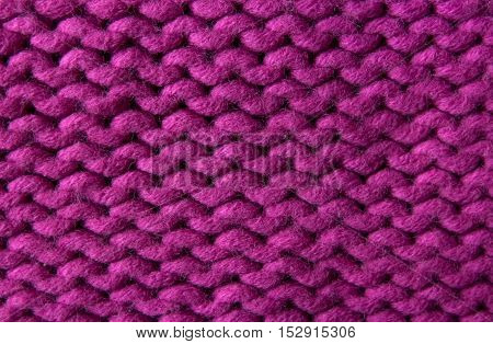 Large horizontal pink knitted background,the original texture
