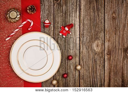 Christmas decoration background over wooden table background. Horizontal photo taken from above, top view with copy space for text and other web or print design elements.