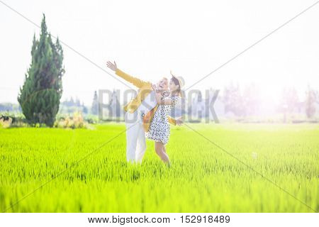 Multi ethnic inter racial couple in a field