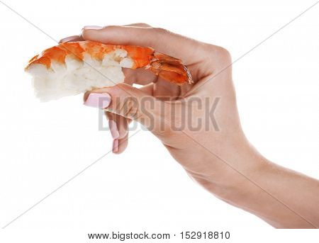 Female hand holding delicious shrimp sushi, isolated on white