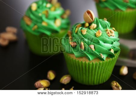 Pistachio cupcakes on table