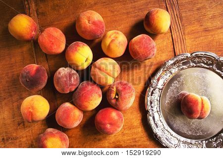 Fresh juicy peaches on the kitchen table