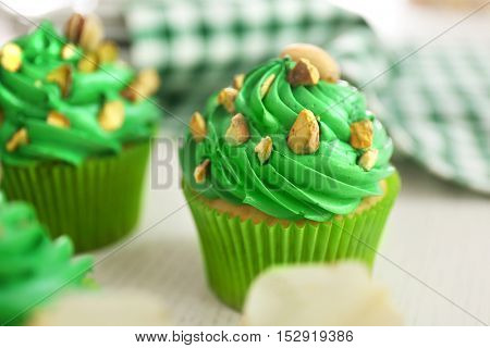 Green pistachio cupcake on table