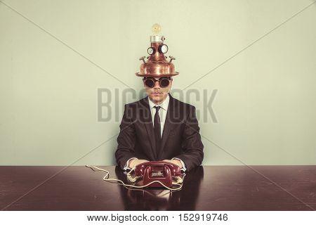 Vintage businessman sitting at office desk indoor