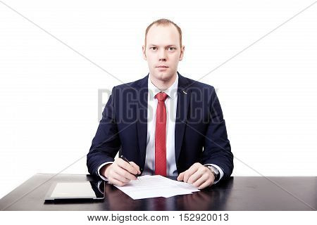 The man at the desk before signing the contract. Looks forward. Isolated on white background