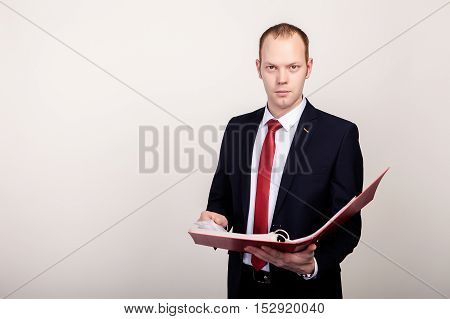 Busniessman posing with clipboard isolated on white background.