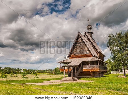 The traditional russian wooden church before the storm in the ancient town of Suzdal Russia. Golden Ring of Russia.