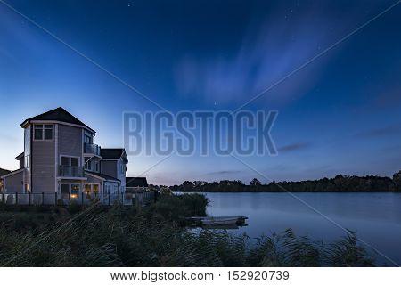 Stunning Night Sky Astrophotography Landscape Image Of Stars Over Still Lake