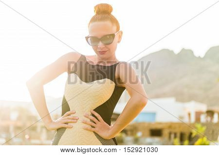 Young cool fashion woman posing over blue sky