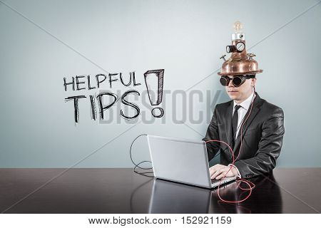 Helpful tips text with vintage businessman using laptop at office