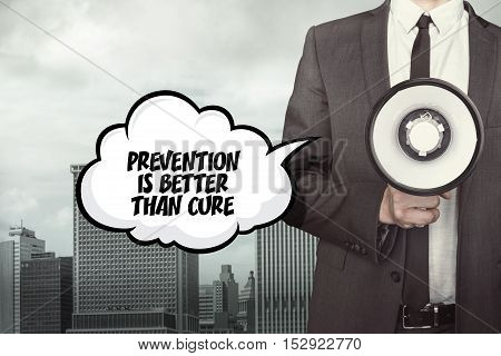 Prevention is better than cure text on speech bubble with businessman holding megaphone