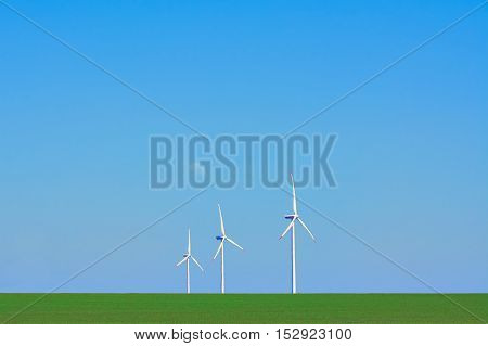 Three Wind Turbines in heat haze against of Blue Sky