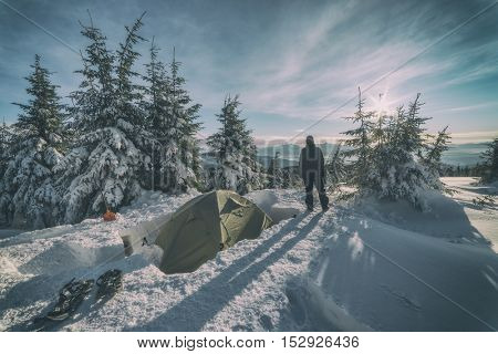 tent in the high mountain on winter time, toned like Instagram filter