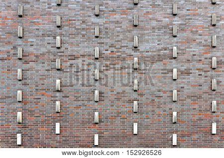 Texture maroon brick wall with vertical rectangular elements.