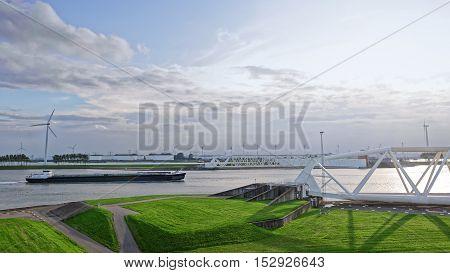 Large oil tanker going trough dam in Rotterdam