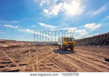 Excavation site with construction machine at work