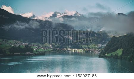 Amazing view of the Lungerersee lake in the morning mist. Lungern village, Switzerland, Europe. Toned like Instagram filter