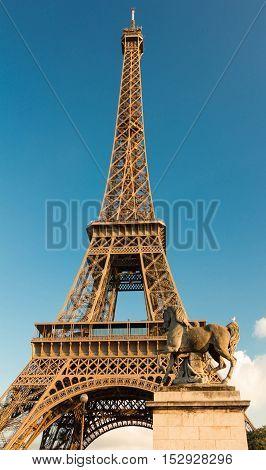 The Eiffel tower and horse sculpture of Iena bridge Paris France.