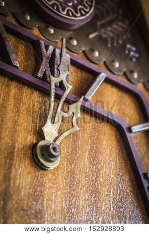 Old wooden wall clock with a cuckoo close up.
