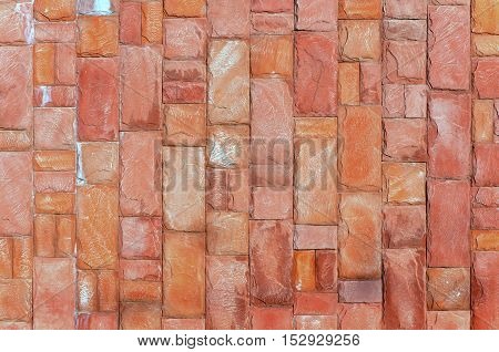 The texture of an orange or the red walls of the stone blocks. The background pattern.