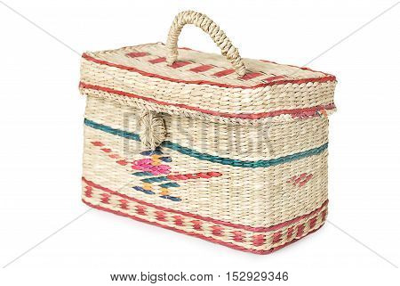 wicker box with handle and ethnic ornaments