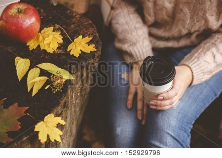 woman's hand holding paper cup of coffee. Good morning concept.