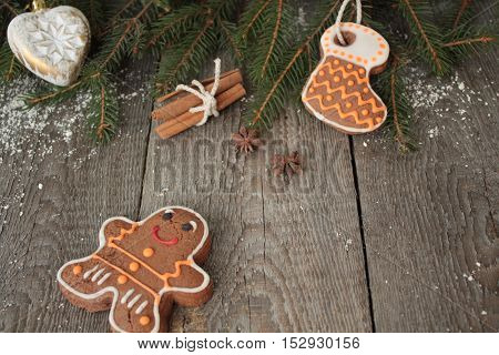 Gingerbread, Christmas ornament, fir tree, snow on wooden background , cinnamon, star anise