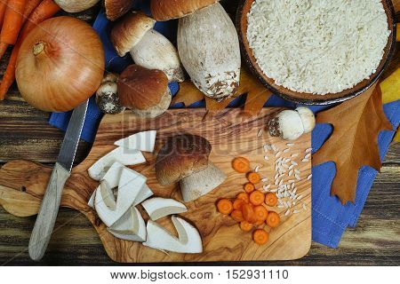 Cooking risotto with wild mushrooms boletus ans rice