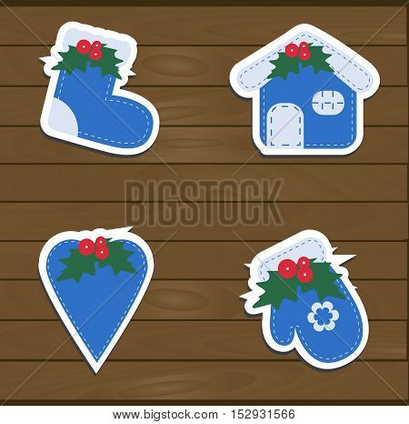 Set a festive children's Christmas stickers. New year collection blue templates labels and badges for decoration or congratulations gift. There are mittens socks heart and home. Baby vector illustration.