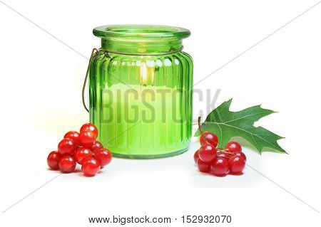 Christmas still life with candle and cranberry