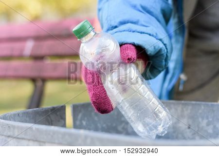 Indigent Senior Woman Scrounging Through A Bin