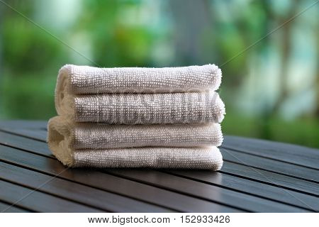 bath towel on the wood table in the garden