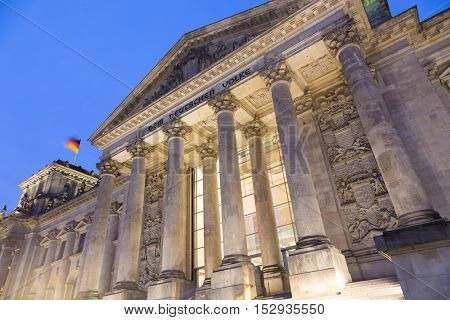 View of famous Reichstag building, seat of the German Parliament , Deutscher Bundestag, illuminated in dusk, Berlin Mitte district, Germany.
