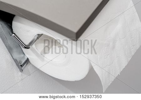 Toilet Paper Roll On Wall Of Modern White Bathroom