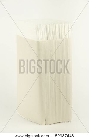 Paper napkins. Stand. Vertical photo, white background