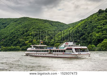 Assmannshausen Germany - May 23 2016: Inland Passenger Vessel Godesburg on the Rhine River in cloudy weather near Assmannshausen village Rhine Valley Hesse Germany.