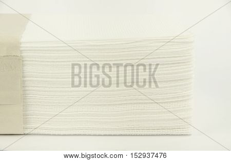 Lying paper napkins. Horizontal photo, white backround