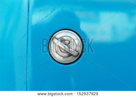 Fuel tank cap on vintage blue car