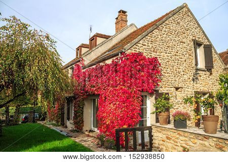 front view on traditional French cottage in early Autumn