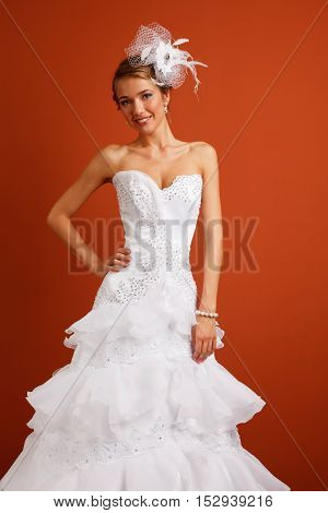 Young cheerful bride on the bright brown background