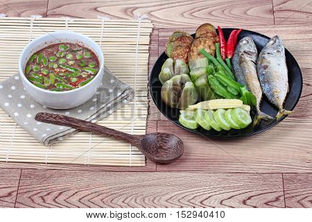 Spicy shrimp paste dip (Nam Prik Kapi in Thai) served with side dish as deep fired mackarels,boiled long-eggplant,lentils,winged bean ,red hot chili pepper and cucumber.