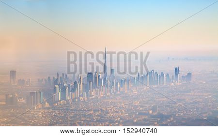 DUBAI, UAE - FEBRUARY 20: Sunset over downtown Burj Dubai February 20, 2016 in Dubai, United Arab Emirates. Dubai is biggest city of UAE and important financial centers of the Middle East economy