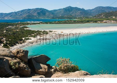Wonderful aerial view on famous beach Villasimius and mountains around in Sardinia Italy.