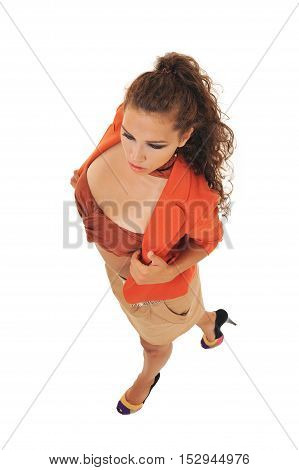 Full-length portrait young elegant woman in brown skirt, orange jacket and brown bra. Fashion studio shot.