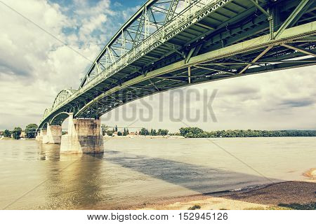 Maria Valeria bridge joins Esztergom in Hungary and Sturovo in Slovak republic across the Danube river. Retro photo filter. Architectural scene. Transportation theme.