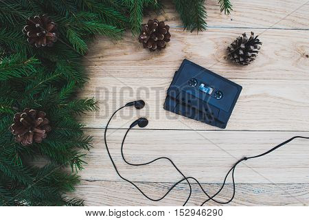 Christmas decoration and old audio cassettes on a wooden table